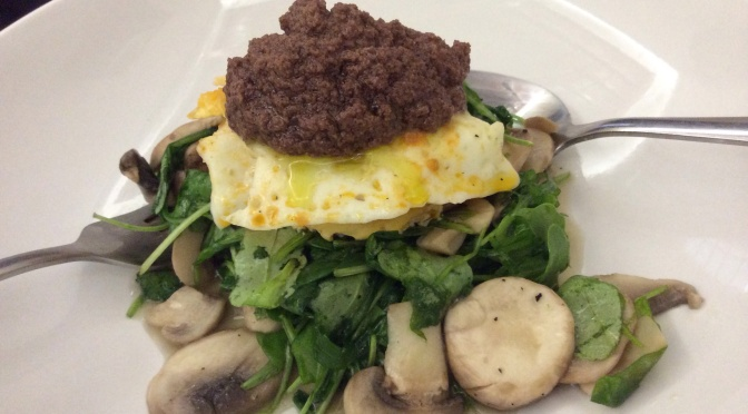 Primed Egg Stack of Wilted Greens, Buttered Mushrooms and Olive Tapenade