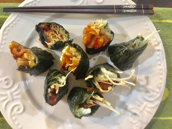 Kimbap Wrap with European cream cheese, enoki mushrooms and spicy Korean squid.