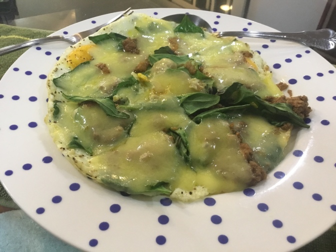 """Primed Fried Eggs """"Pizza"""" with grass-fed beef, spinach and cheddar cheese."""