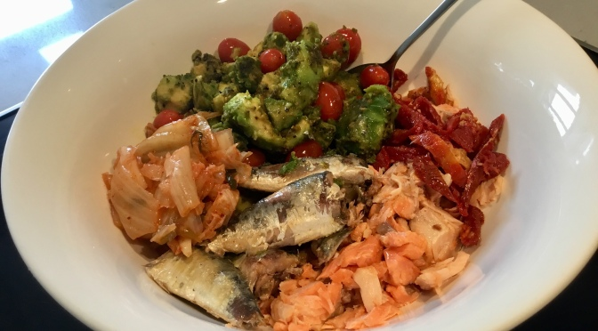 Butter Fried Avocado with Hot Smoked Trout, Sardines, Cherry Tomatoes, Semi-Dried Tomatoes and Kimchi